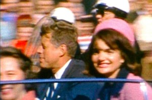 US-President-John-F-Kennedy-and-the-late-Jacqueline-Kennedy-R-riding-in-a-motorcade-in-Dallas-Texas-moments-before-he-2669093